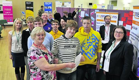 This Is Wiltshire: Enterprise Warminster chairman Pip Ridout, front left,  with young jobseekers and employers from around the district at the Job Fair