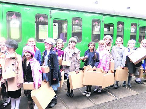 This Is Wiltshire: Children from Horningsham Primary School find out a little of what life was life for a Second World War evacuee during a day trip to the East Cranmore Steam Railway Centre, where they wore period dress