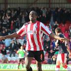 Ruthless: Clayton Donaldson celebrates his second goal against Crawley Town