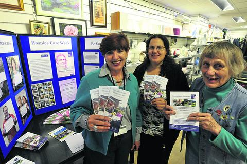 This Is Wiltshire: Lilias Fisher, left, of Dorothy House family support team, with Warminster shop volunteers Cara Brito and Daphne Gearing, right