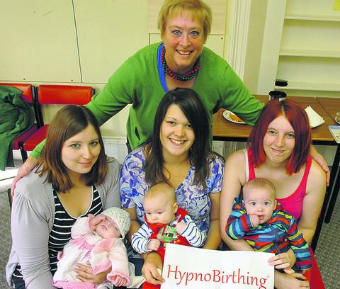 Sally Carr, back, with some of her more recent hypnobirthing mothers and babies, from left, Lorna Heatley and Devon, six weeks, Kelly Hodges with Elijah, three months, and Megan Tanner with Max, six months