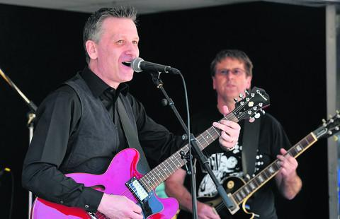 This Is Wiltshire: Graham Mack, left, and Gavin Jones playing in the Graham Mack Rock Band during the St George's Day celebrations in the town centre last year