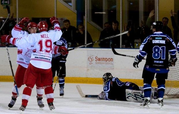 This Is Wiltshire: FALSE DAWN: Aaron Nell celebrates a goal against Sheffield on Saturday night