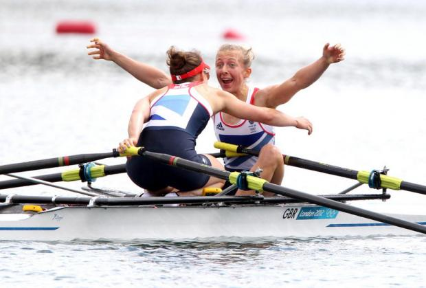 "This Is Wiltshire: WE'VE DONE IT: Kat Copeland, in a now-iconic image, screams ""we've won the Olympics, we're going to be on a stamp"" to her partner Sophie Hosking after sealing gold at Eton Dorney in the lightweight sculls in August"