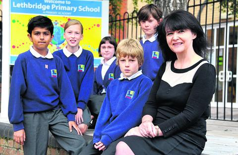 Lethbridge Primary School headteacher Violet Mclaren with pupils, from left, Rohan-Paul, Jennifer, Hannah, Daniel and Etai
