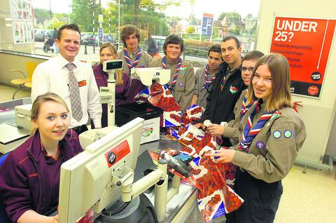 This Is Wiltshire: Cashier Jasmine Ainsley and store manager John Hunter with the Scouts