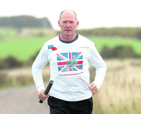 This Is Wiltshire: Martyn Bird trains for his 300-mile run from the Thiepval memorial in France to Staffordshire to raise money for the Royal British Legion