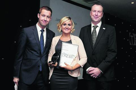 This Is Wiltshire: Jamie-Leigh Clayton with her Regional Apprenticeship Champion of the Year award, presented by Phillip Taylor, left, from The Apprentice, and John Chudley, southern divisional apprenticeship director at the Department for Business, Innovation and Sk