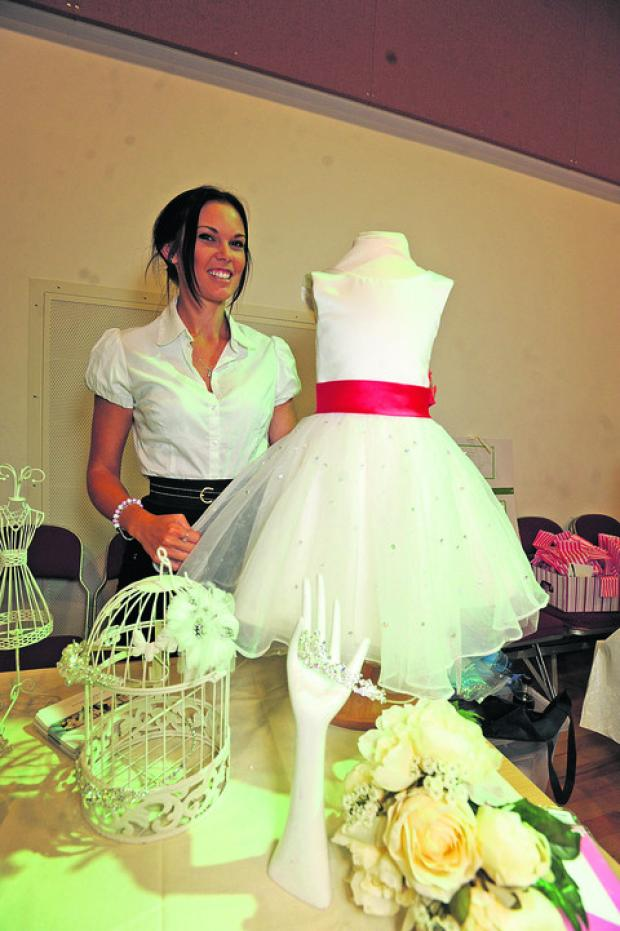 IN WHITE: Lucy Luxford at the Belle of the Ball stand at last year's fair