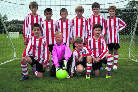This Is Wiltshire: Devizes Town U10s wearing their new kit, which has been provided by Norman Roberts from the fish-and-chip shop Lemon Plaice