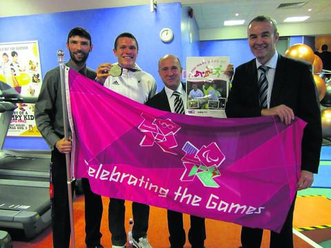 This Is Wiltshire: LEGACY: From left, Paul Pritchard, senior sports development officer at Wiltshire Council, Paralympic silver medallist Aaron Moores, Coun Jerry Kunkler and Mike Greenan, president of Trowbridge Amateur Swimming club