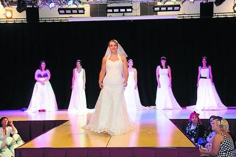 This Is Wiltshire: Gowns on the catwalk at last month's Wedding Fair at the Trowbridge Civic Centre