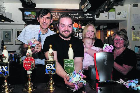 This Is Wiltshire: Adam Glass, of the Farmhouse, with Dan Elliott, Harley Harris, baby Jessica and Janet Harris of the Farmhouse at the fundraising event