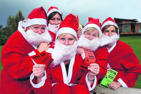This Is Wiltshire: Ready for their Santa dash, new chief executive Liz Brown, Phillippa Watson, Emily Knight ,retiring chief executive Sarah Whitfield and Katrina Sudbury