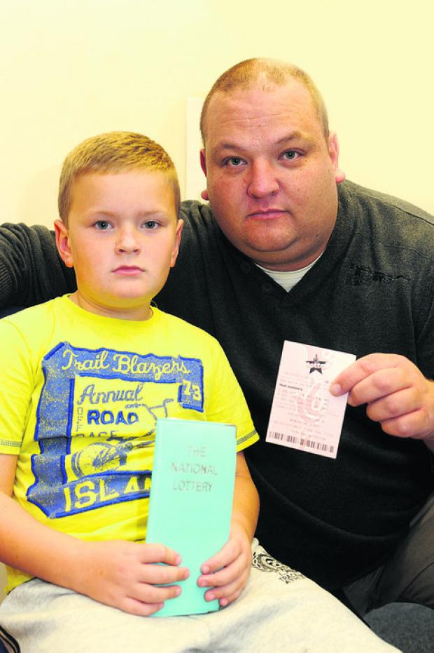 Zak Haines with father Trevor, who is angry at the way they were treated while trying to buy lottery tickets at an Asda kiosk in Frome