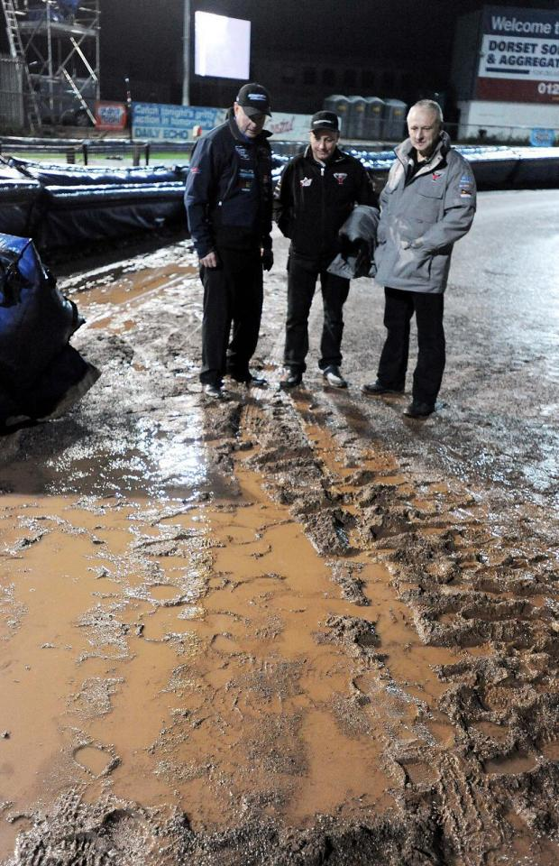 WET WET WET: Neil Middleditch, Alun Rossiter and Gary Patchett inspect the Poole track