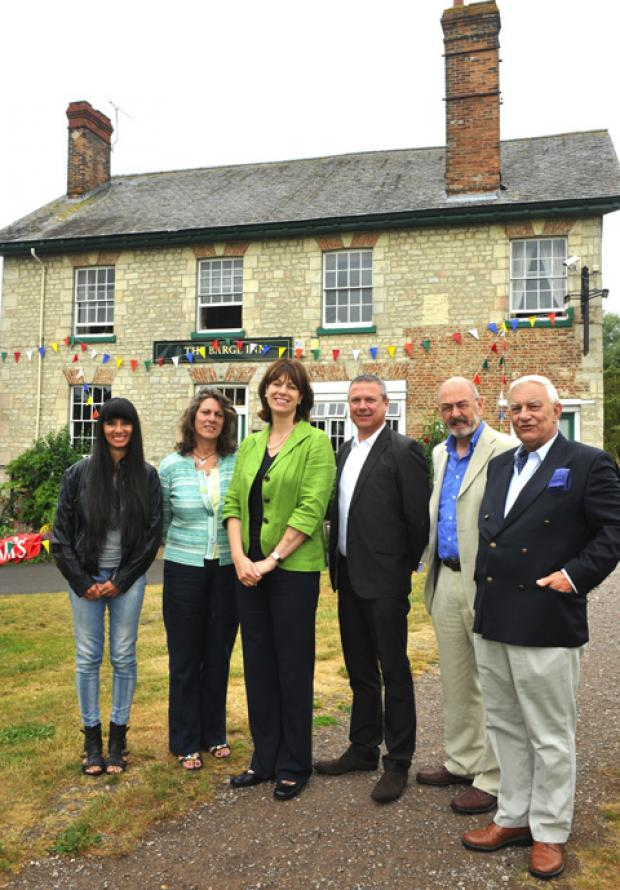 This Is Wiltshire: Flashback to July 2010 when MP Claire Perry met with members of the village buy-out group and Lottery officials who backed the scheme