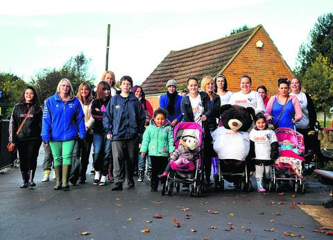 This Is Wiltshire: Sophie Miles, centre front with baby Aaliyah Gray in a pushchair