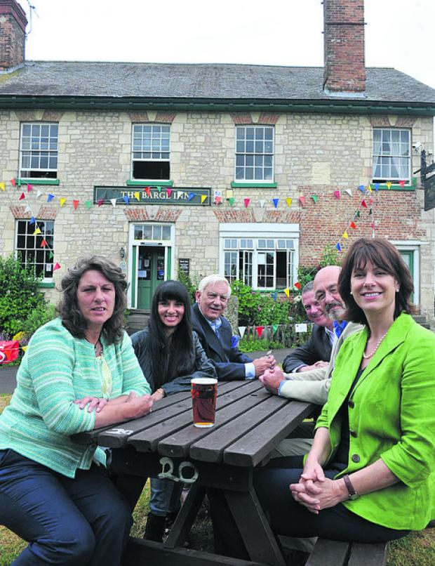 This Is Wiltshire: Claire Perry MP met the Barge Inn's buy-out group and Lottery officials in 2010. She is pictured, right, with Bev Mcenaney, Sandra Bhatia, John Brewin, Mark Cotton, of the National Lottery, and Terry Kemp