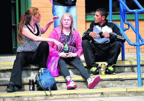 This Is Wiltshire: A group of people drinking alcohol on the steps of Swindon Magistrates Court' last month while a case regarding an Asbo due to alcohol was heard inside