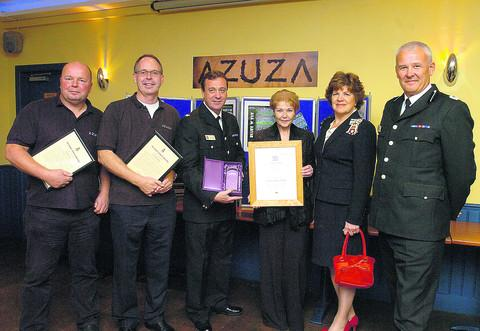 This Is Wiltshire: From left, Mark Gent and Andrew Moyes, both of Azuza, with DSU Jerry Dawson, volunteer Denise Lumby, Lord Lieuteant Sarah Rose Troughton and acting chief constable Steve Headley