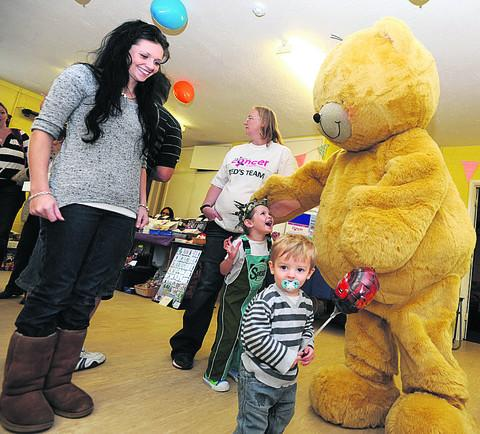 This Is Wiltshire: Organiser Lin Ryan, Roxy Russell with Big Ted and Junior Hickman at the Kingsley Road Community Hall charity event