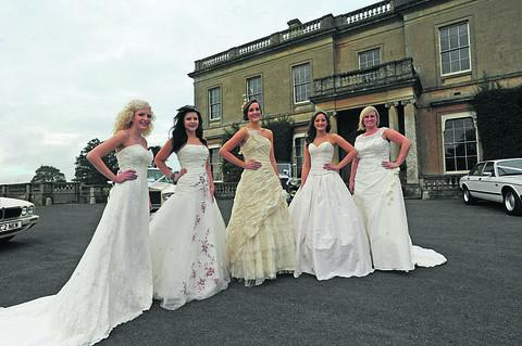 An array of wedding dresses from The Bridal Lounge add sparkle to the fair at  Hartham Park