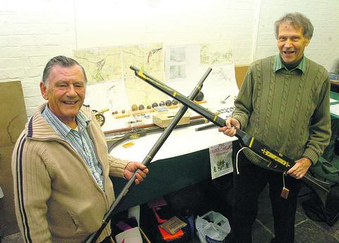 Keith Genever and Bill Underwood with some of the finds from the battle on display
