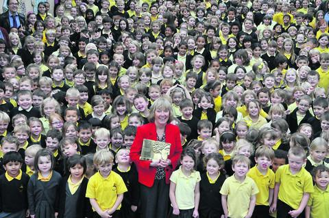 Anne Bull celebrating with her pupils at Weston All Saints School in Bath