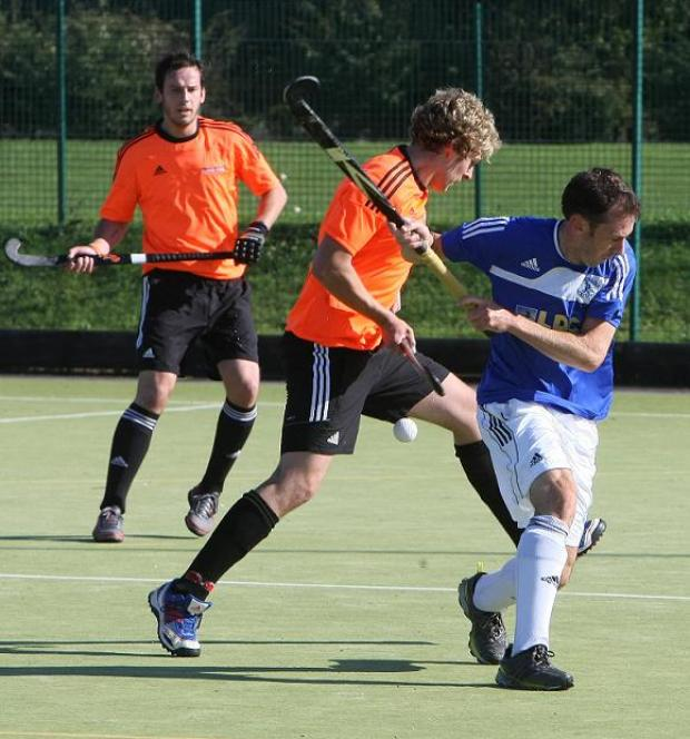 This Is Wiltshire: Swindon's Jake Biddle, centre, in action