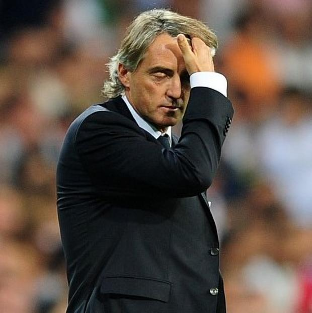 This Is Wiltshire: Roberto Mancini took responsibility for Manchester City's defeat at Ajax.