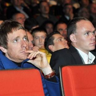 This Is Wiltshire: Bradley Wiggins, left, and Chris Froome look on during the 2013 Tour de France Presentation in Paris