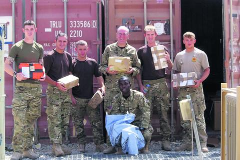 The Padre for 3 Yorks, major John Duncan, with members of Camp Bastion staff sorting out the mail for sending to the front line in Afghanistan