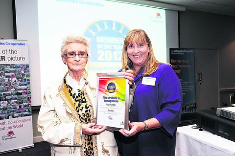 This Is Wiltshire: Kaye Franklin, 72, of Kembrey Park, has been honoured with the top award at the Midcounties Co-operative Member of the Year Awards. She is with Ruth Fitzjohn, director at the event.