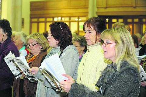 This Is Wiltshire: Athenaeum singers and newcomers rehearse songs at Christ Church