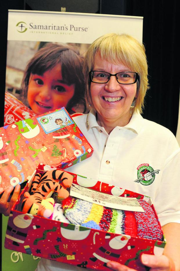 This Is Wiltshire: Volunteer Beth Viveash with some of the donated shoeboxes