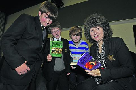 Caroline Lawrence signs books for Clarendon College pupils Alex Mudge and Leyon Cleer and Holbrook School pupil Adam Bridgwater