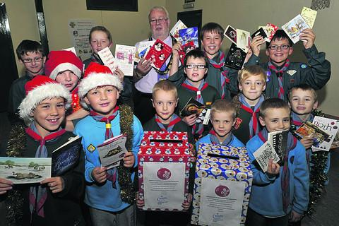 This Is Wiltshire: Melksham Scouts, Cubs and Beavers get ready for their Christmas card delivery rounds in the town, which are being supported by Mayor Chris Petty