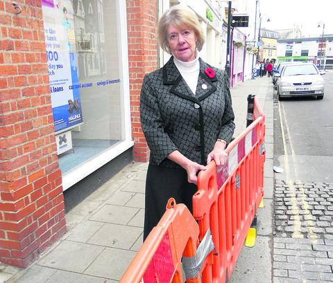 Coun Sue Evans with the plastic barriers in Maryport Street, Devizes