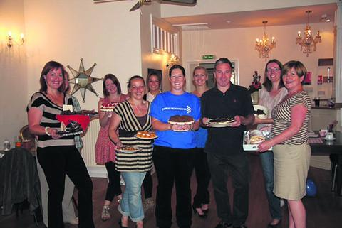 This Is Wiltshire: Mel Cook, Helen O'Brien, Mel Weeks, Stacie Willis, Jessica Hancock, Jacqueline Muttock, Steve Chadwick, Mel Pitman and Catherine Chadwick with their array of cakes