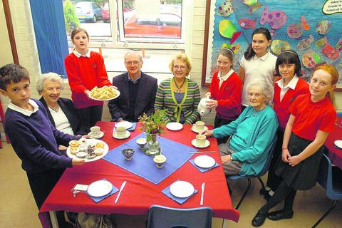 This Is Wiltshire: Wilmer Anscombe, David Mortimer, Gloria Mortimer and Mildred Abrahams are pictured with Josie, Jaden, Ellie, Amelia, Robyn and Tabby at Christian Malford harvest tea party
