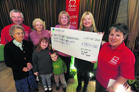 Back row, Nick Harding, chairman of Chippenham area BHF, Maureen Uzzel, Hayley Uzzel, Fiona Waind, who ran the Great North Run for BHF, Sarah Harding, of BHF Chippenham area, front, Dot Ings, Kington Langley BHF organiser, Maddy and O