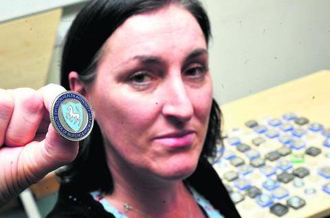 This Is Wiltshire: Claire Barker at the Great Western Hospital has found a large number of nurses badges and is trying to locate their owners