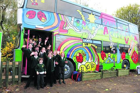 This Is Wiltshire: Lawn Primary School has turned an old Thamesdown Transport double decker into a playbus