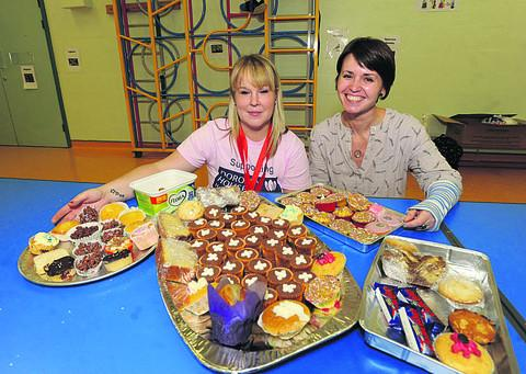 Mum Laura and Ashton's teacher Emma Gray at yesterday's cake sale