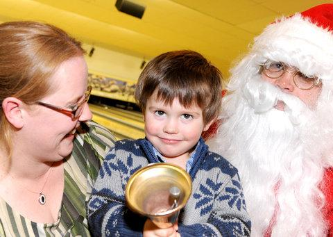 This Is Wiltshire: Three-year-old Rhys Hopkins-Staples, pictured with his mum Melanie and Santa. Rhys was treated to a bowling session at Tenpin, Shaw Ridge, and a visit from Santa as part of our Christmas Wish appeal last year