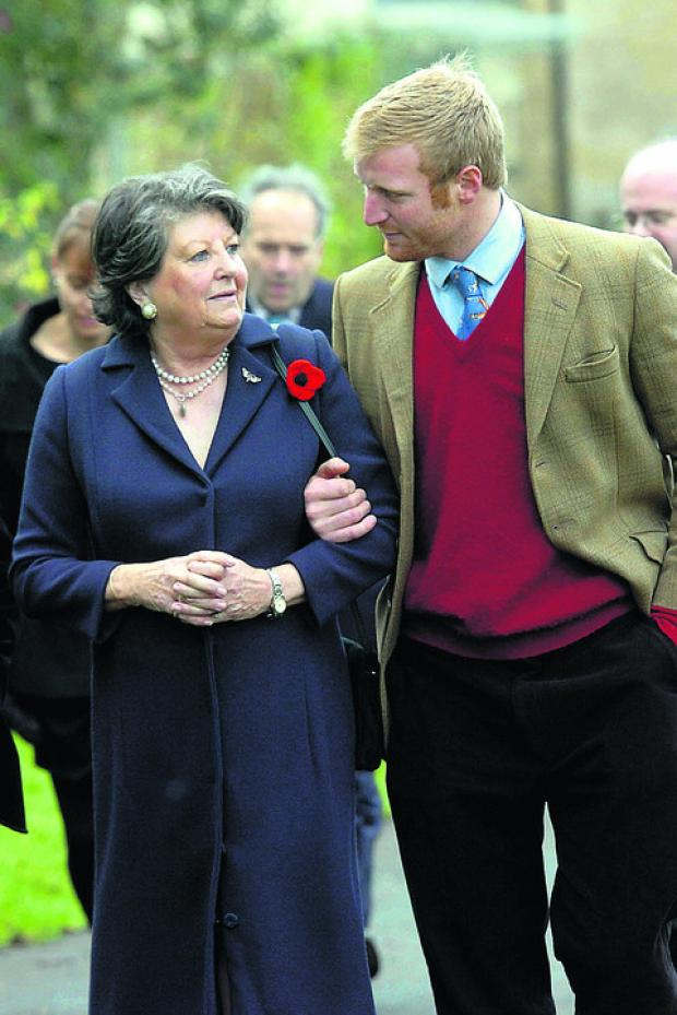 This Is Wiltshire: Lady Oaksey arrives at the church with Rory Boswell