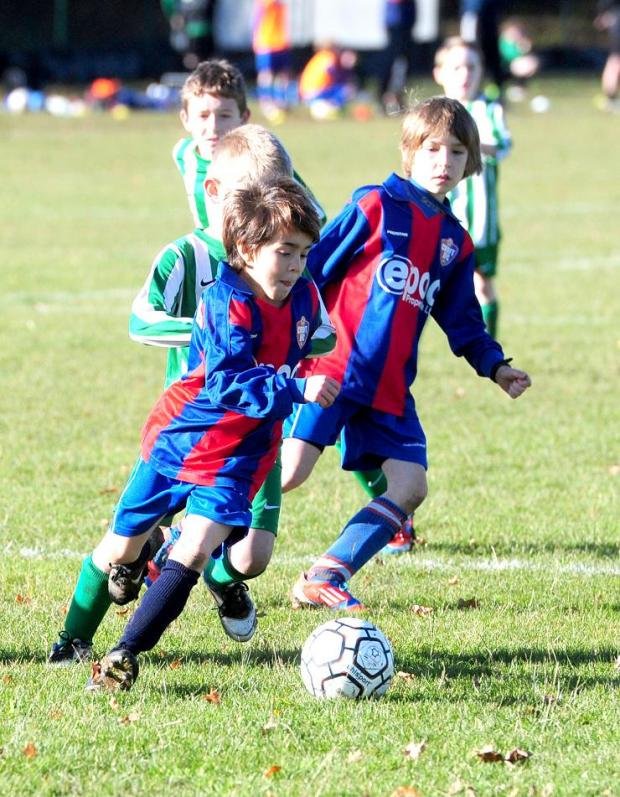 This Is Wiltshire: Nathaniel Knibb surges forward for Croft Juniors Blue