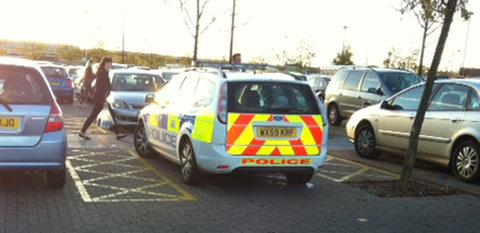 This Is Wiltshire: The police car photographed by an Adver reader parked in the disabled space at Asda