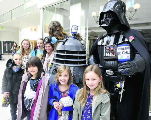 Members of the Corsham-based Charity Sci-Fi group collecting for Children in Need in the Shires, Trowbridge